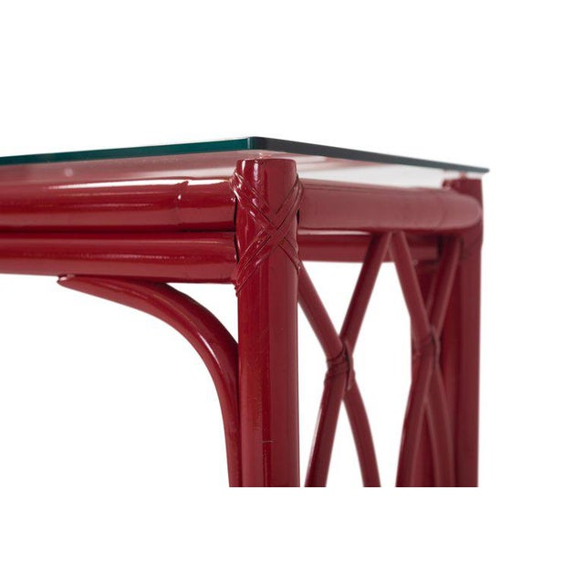 Regency red bamboo vanity table with rectangular glass top and large matching mirror. Both table and mirror show lot of...