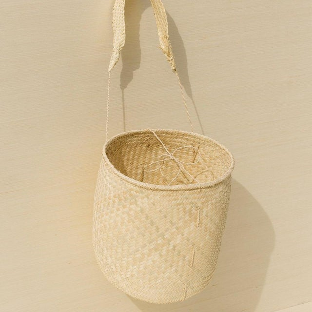 Handmade palm basket with handy strap to carry your market goods or store your favorite scarves. These baskets are...