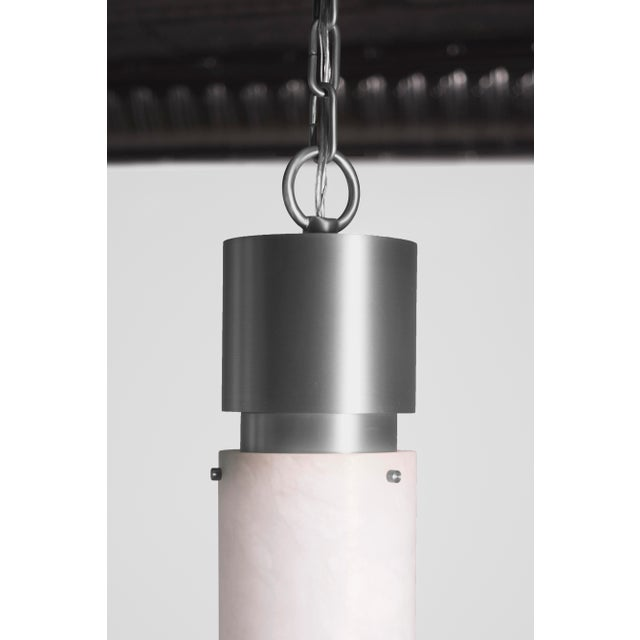 This contemporary light made of brushed nickel and alabaster is part of the Orphan Work brand and can be used as a ceiling...