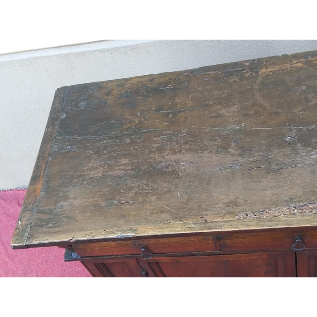 A remarkable example of period Reniassance furniture, this late 17th century Italian Dark Walnut buffet is absolutely...