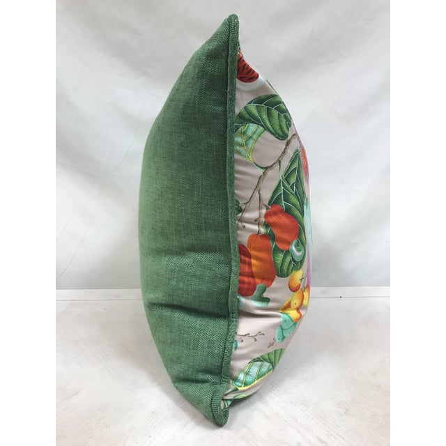"""Face displays a vibrant print of """"Jamaica"""" by Manuel Canovas on 100% fine cotton Back and cording a green solid brushed..."""