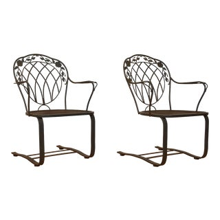 Pair of Vintage Woodard Wrought Iron Bounce Patio Rockers For Sale