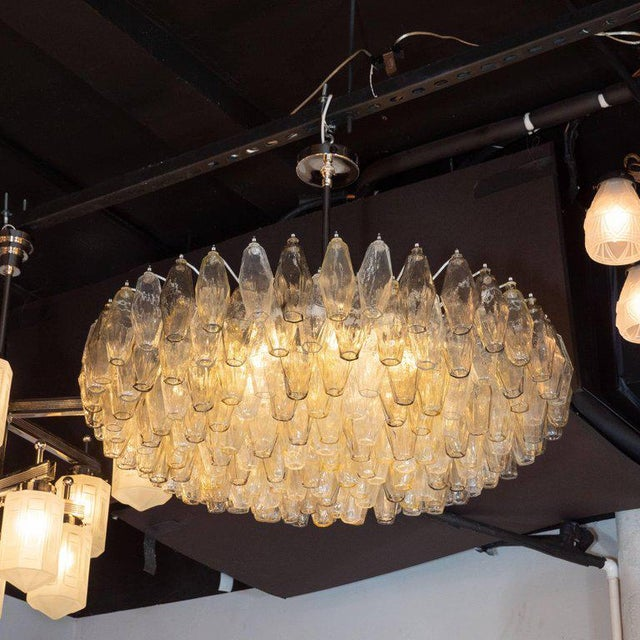 This stunning chandelier was realized by hand in Murano, Italy- the islands off the coast of Venice renowned for centuries...