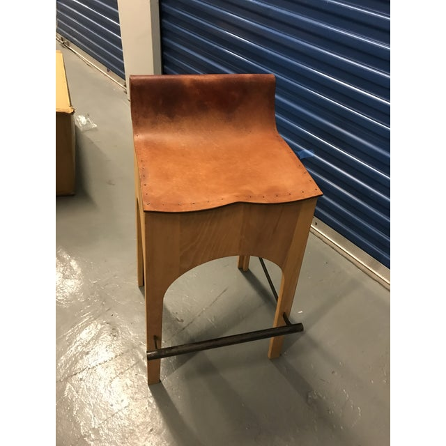 For Sale is a wood and leather Bar stool by Lostine. The Jack Leather stool is the perfect compliment to its sturdy wooden...