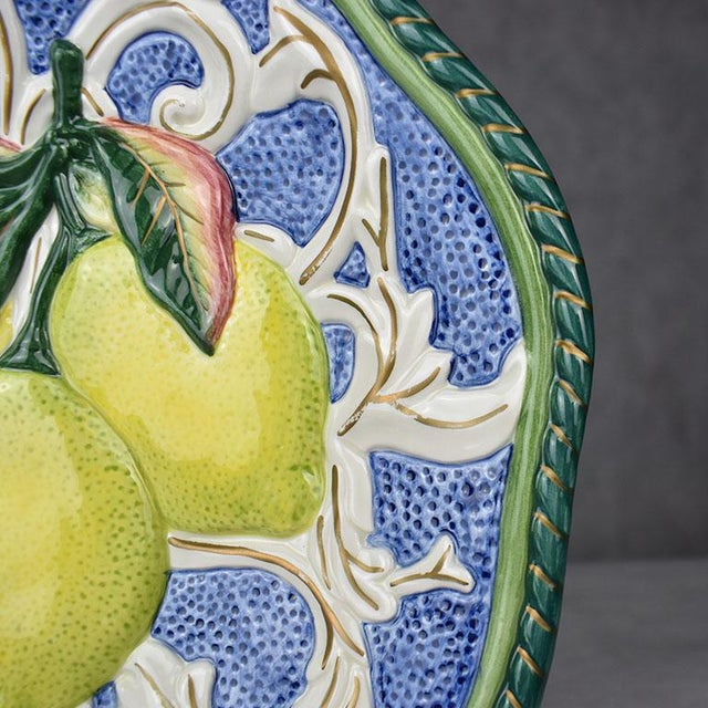 Octagonal majolica lemon motif plate in green, yellow, blue and red. This piece by Fitz and Floyd would be a fabulous...