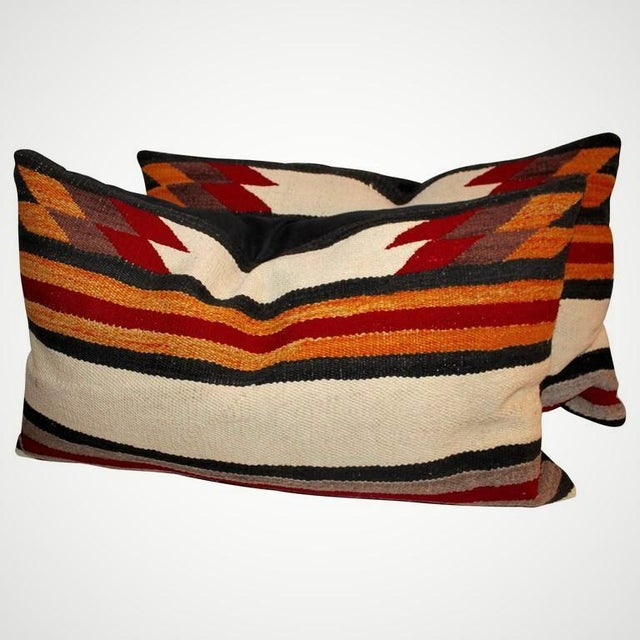This pair of Indian weaving bolster pillows are in great condition with black cotton linen backings.