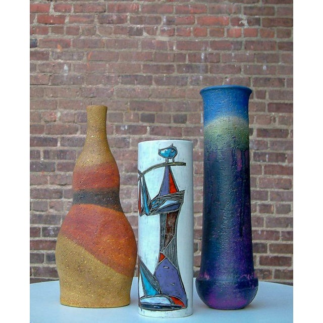 """Italy Circa 1950 One vase has a gourd form with the classic matte drip glaze signed Fantoni Italy for Raymor. 13"""" H x 5"""" W..."""