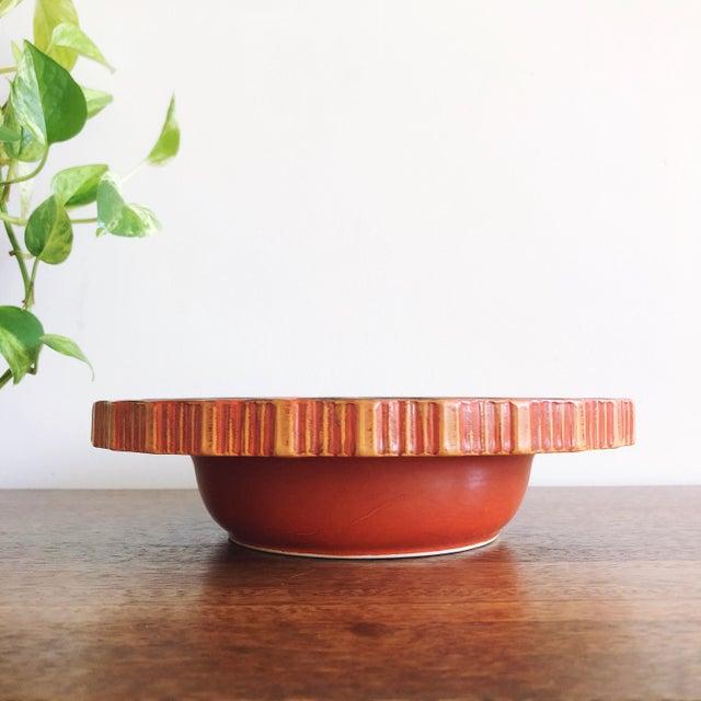 Vintage Japanese hand-painted black and orange ceramic bowl.