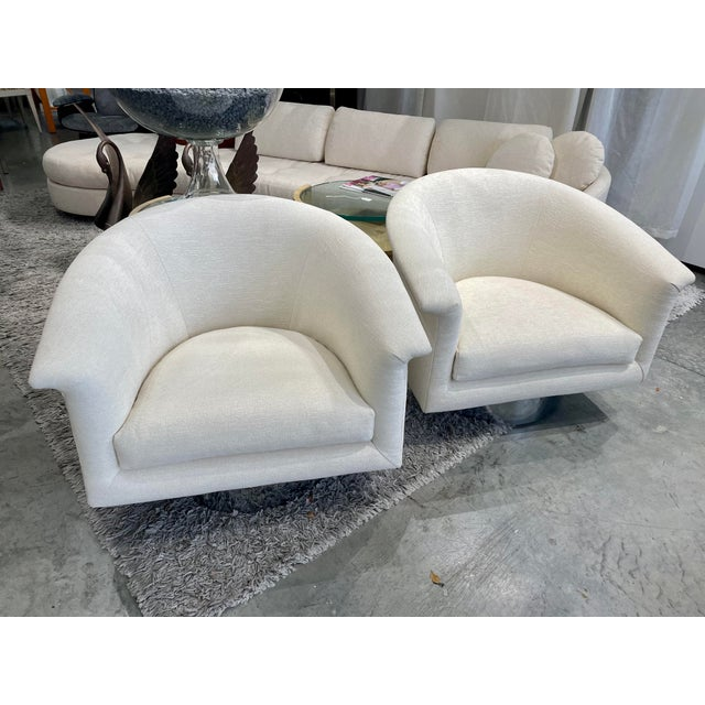 This pair of 1970s chairs have been professionally reupholstered in a beautiful high quality ivory chenille/boucle fabric,...