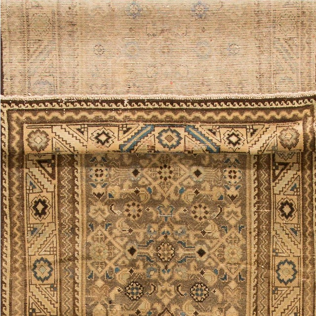 1940s hand-knotted Persian Malayer carpet with a tan/beige field, light blue and darker brown accents, traditional all-...