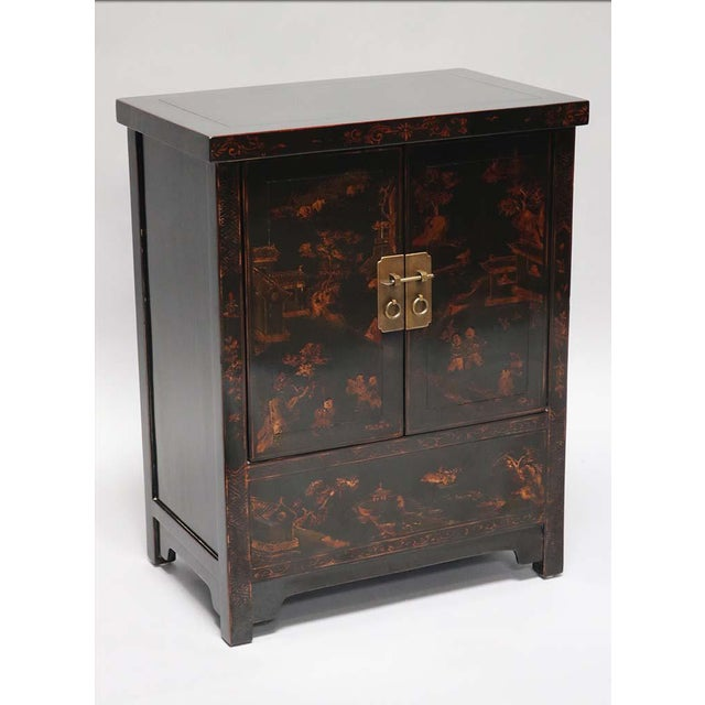 Black Lacquered and gilt painted cabinet from Tianjin Province China