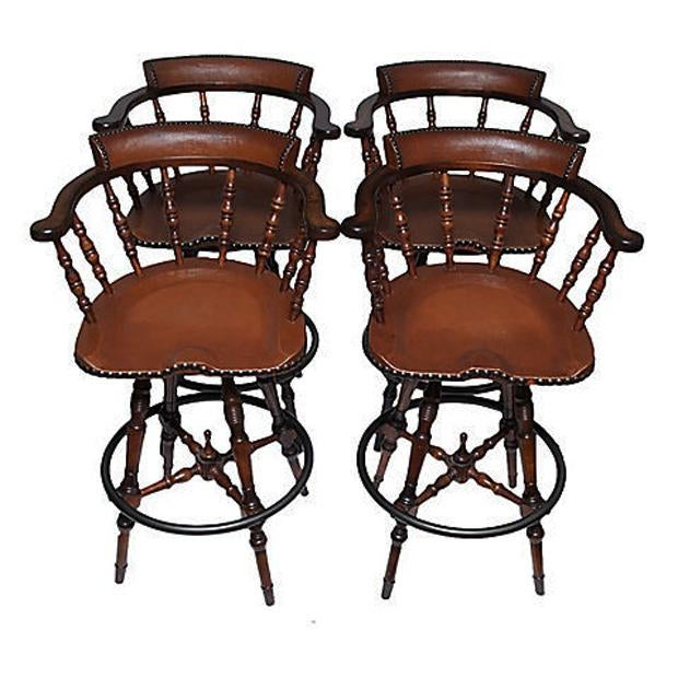 A beautiful Game or Drinks table and four chairs set. The table has a faux tooled leather round top, four chairs have...