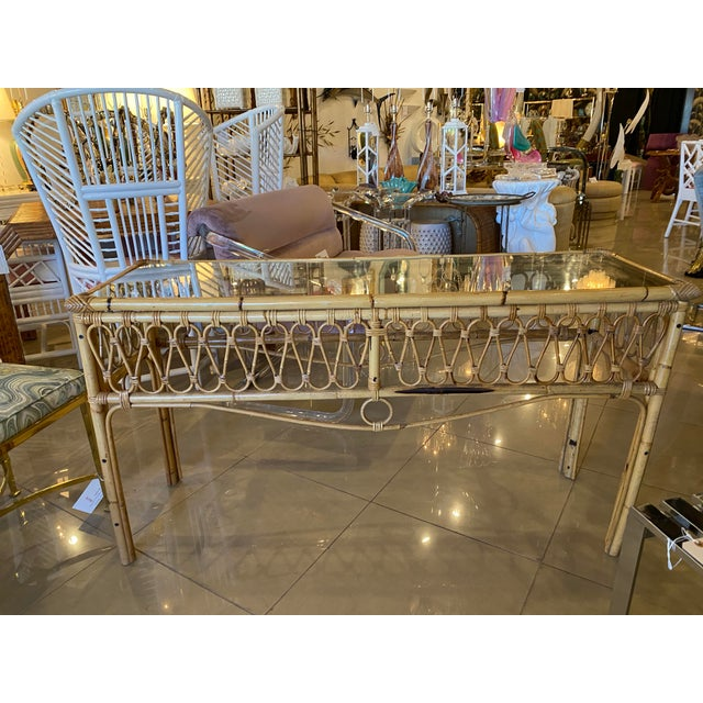 Vintage rattan console table with glass top. No missing or broken pieces of rattan.
