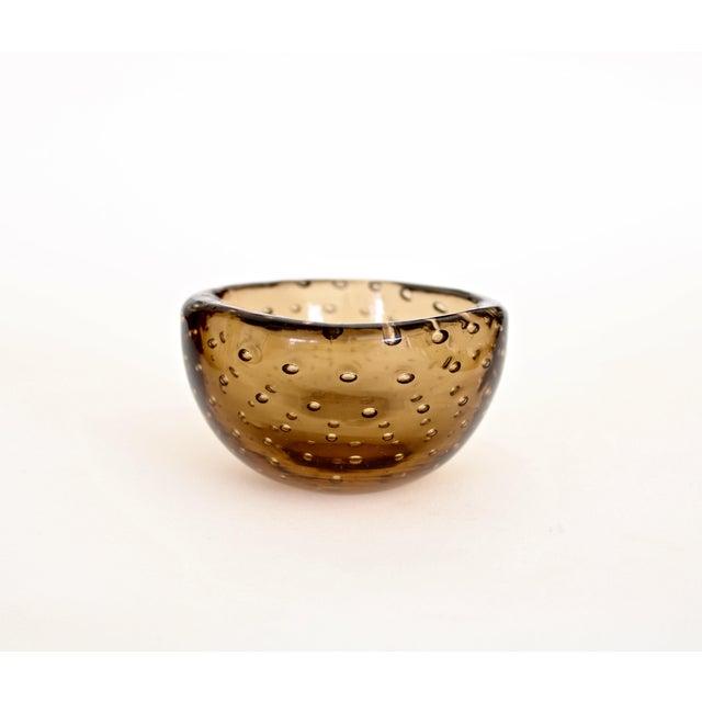 Small delicate amber brown Bullicante bowl designed by Carlo Scapra for Venini. The Venini glass works was started in 1921...