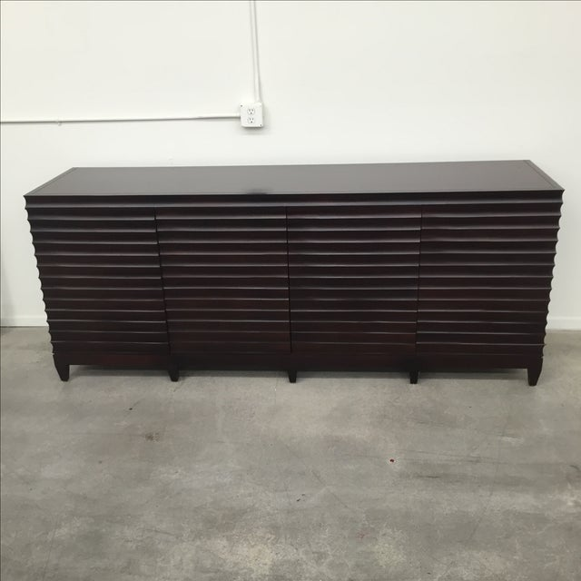 Near flawless fluted cabinet by Barbara Barry for Baker Furniture. This credenza features four doors, horizontal fluted...