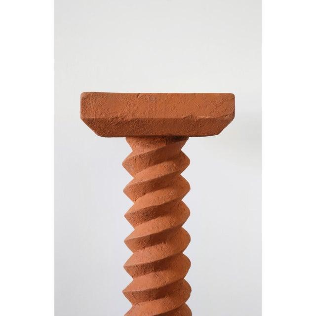 Terracotta pedestals, hand-sculpted, Rooms Dimensions: L 42 x H 110 x W 28 and L 40 x H 148.5 x W 40 Materials: Combined...