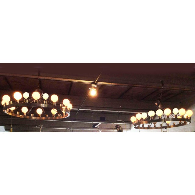 Pair of huge Industrial looking chandeliers, made by the lamp maker de Beloeil. 24 light each US wired and in working...