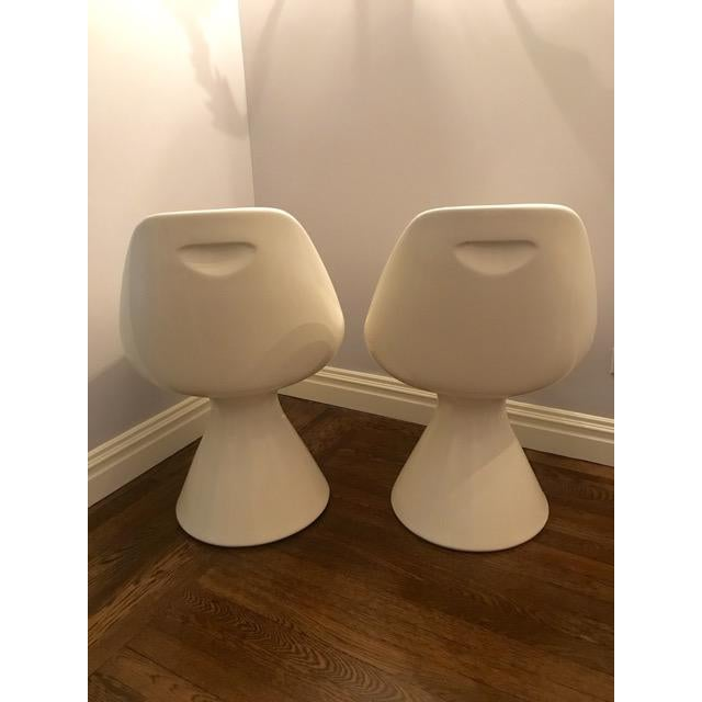 A terrific pair of Mid-Century Modern fiberglass Scoop/ Bucket chairs. They are circa 1960s and can be used as side or...