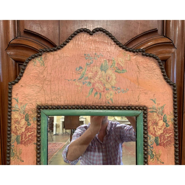 Decorate a powder room or a girl's bedroom with this elegant antique mirror. Crafted in France circa 1910, the carved...