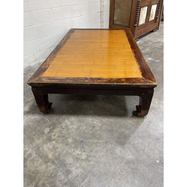 This is a huge piece, so be site to check your measurements! What appears be bamboo top and rustic wood Ming style legs...