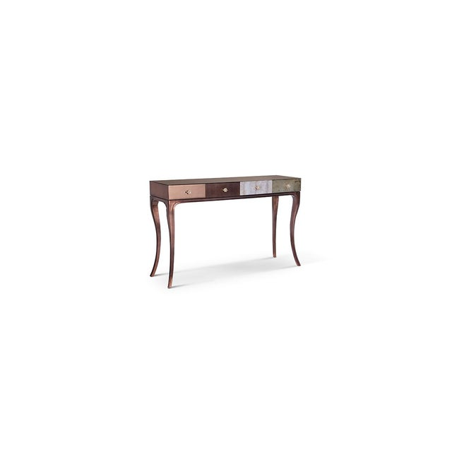 Fierce details packed with primal power, verve and bite wrap this reptilian console. Drawer fronts composed of various...