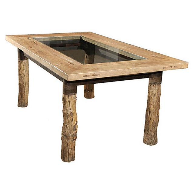 One of a kind glasstop dining table from China. Made with elm burl root with iron stretcher bar base for the table top.