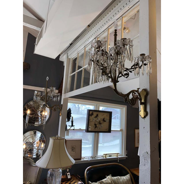 Impressive ornate pair of French neoclassical style relief cast bronze and gilt bronze mounted sconces having seven...