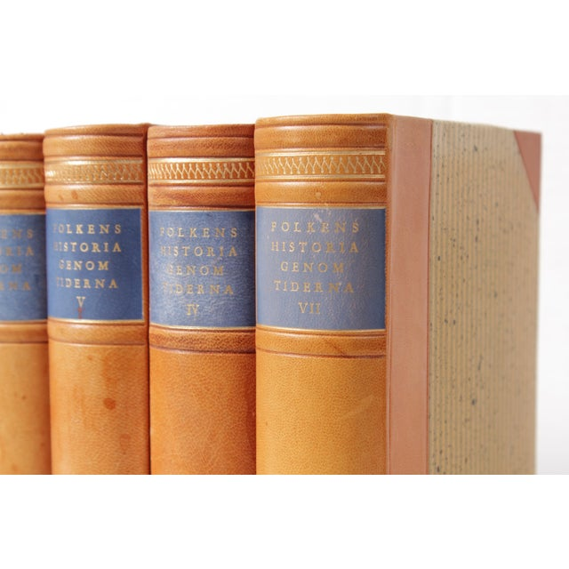 Set of seven Swedish leather-bound books published in the 1950's.