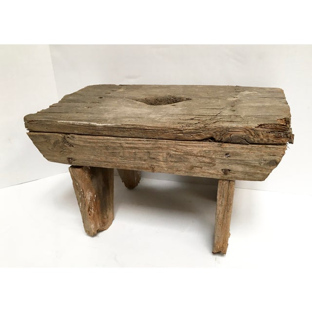 """Rustic handcrafted wood stool. Center cutout """"handle"""". All original hardware. Naturally aged, distressed wood. Perfect for..."""