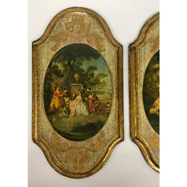 A lovely pair of gilt painted frames made in Florence Italy with prints from the Victorian age. These are in wonderful...