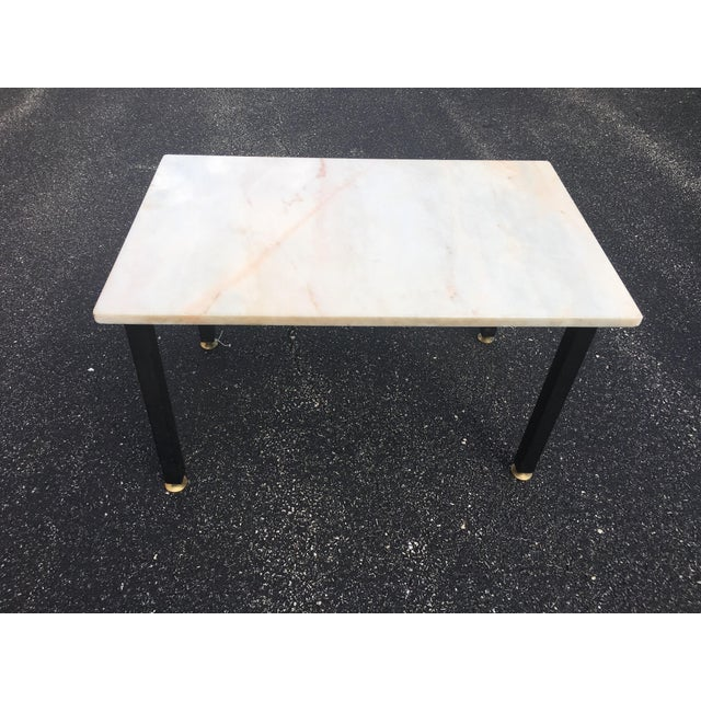 Light pink marble side table with wrought iron base and adjustable gold brass feet. The marble is lovely, with subtle pink...