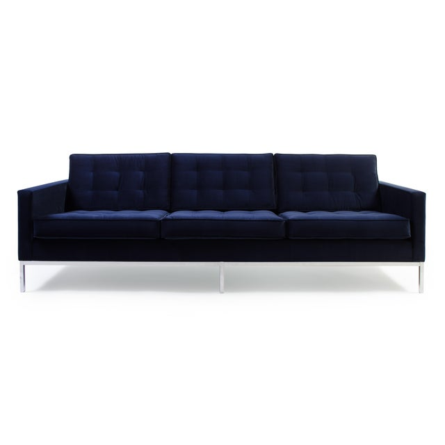 The classic Florence Knoll Sofa, completely restored and reupholstered in navy blue. We restored this piece based on...