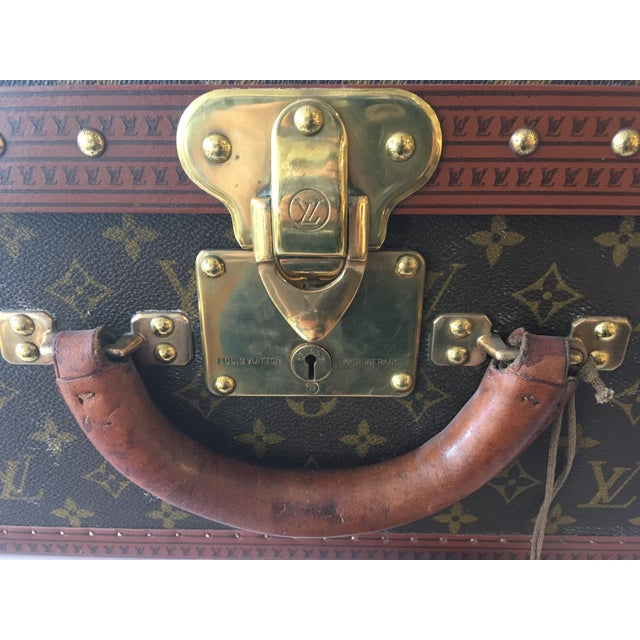 Louis Vuitton leather-handled hardside luggage, with interior tray, and serial number 912043.