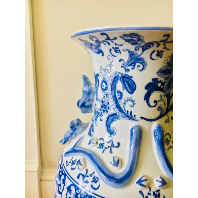 """This is a large 24.75"""" tall Chinese porcelain vases in blue and white color. Images of flowers and charming shogun scenes..."""