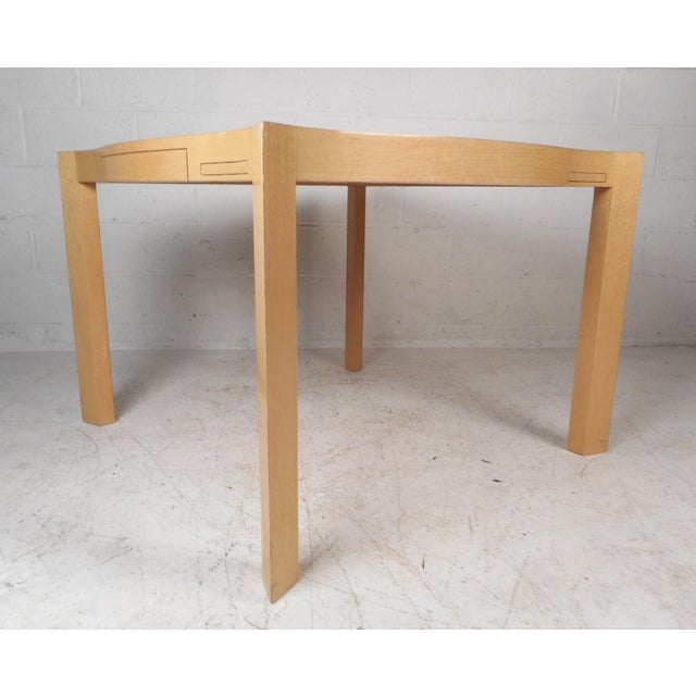 This gorgeous vintage modern game table features a blonde lacquered finish and sculpted top. Four hidden cup holders...
