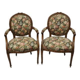 1930s Vintage French Country Louis XV Style Finely Carved Round Back Walnut Arm Chairs- A Pair For Sale