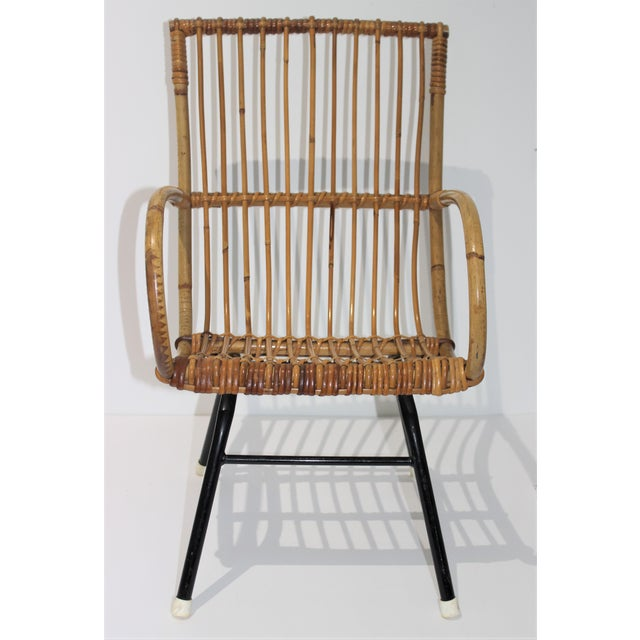 This stylish child's chair dates to the mid-20th century and was acquired in Italy. The piece is attributed to Franco...