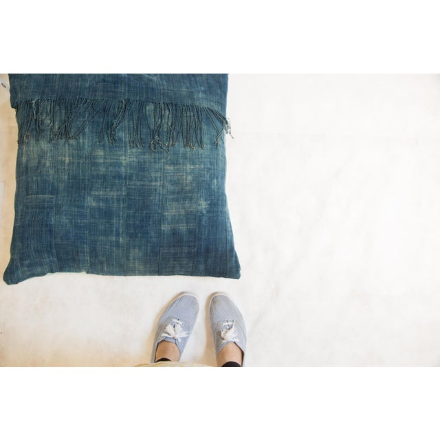 Old New House Original and exclusive handmade floor pillow featuring reclaimed vintage African Indigo textile. This...