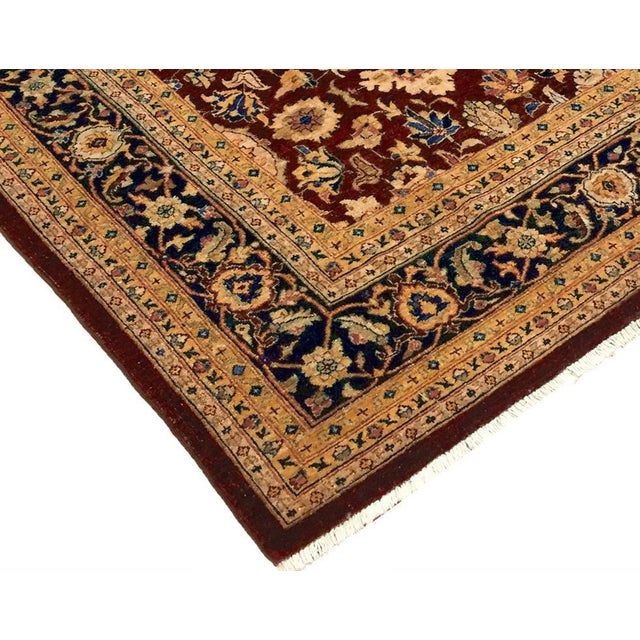 Make a statement in your décor with this beautiful red hand knotted rug crafted by skillful artisan. Intricately design to...