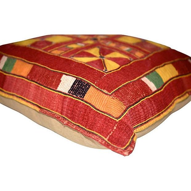 A fabulous, large pillow made with a rare, vintage, hand-embroidered Indian bag textile. This is backed with a rich beige...