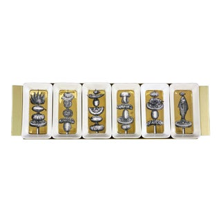 Piero Fornasetti Gold Appetizer Dishes on Original Tray, Spiedi (skewers) Pattern, Early 1960s.
