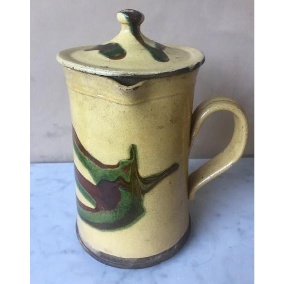 19th Century large Jaspe pottery pitcher with lid. This pitcher was made Savoie region of France around between 1850-1880....