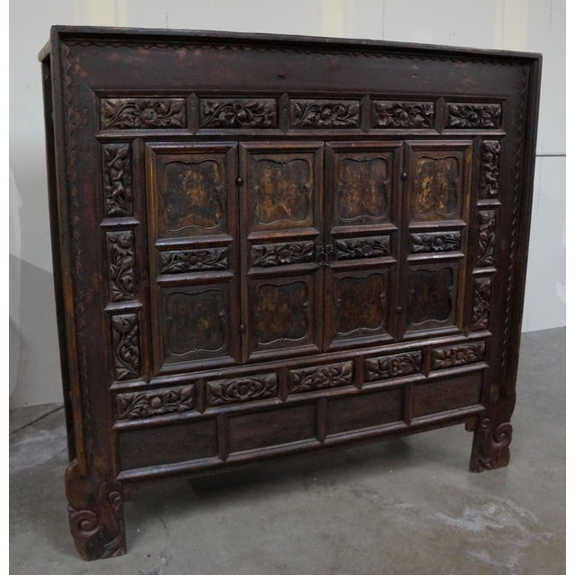 The cabinet is styled after a rare design that was found in Shanxi Province  and dated. Asian Antique Chinese ... - Antique Chinese Cabinet With Bold Floral Carving Chairish