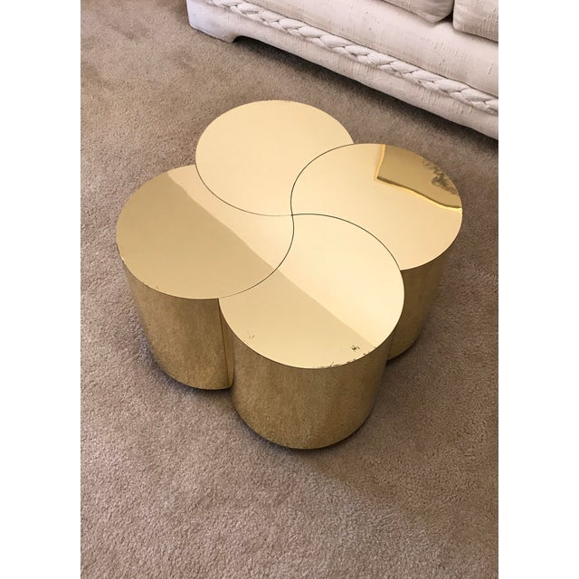 The holy grail of Curtis Jeré pieces, the sought after and rarely found clover table in a gleaming in polished brass,...