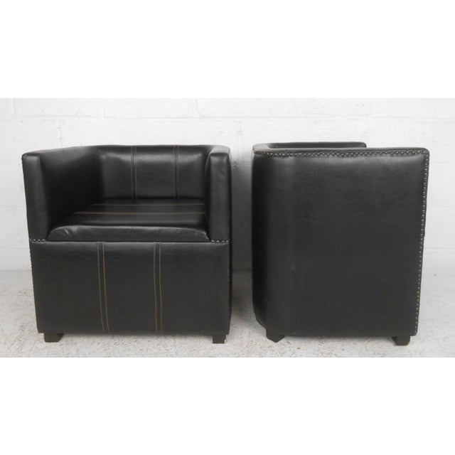 d123bca9aa521 This pair of leather club chairs features a unique squared shape with  studded upholstery makes for. Mid-Century Modern ...
