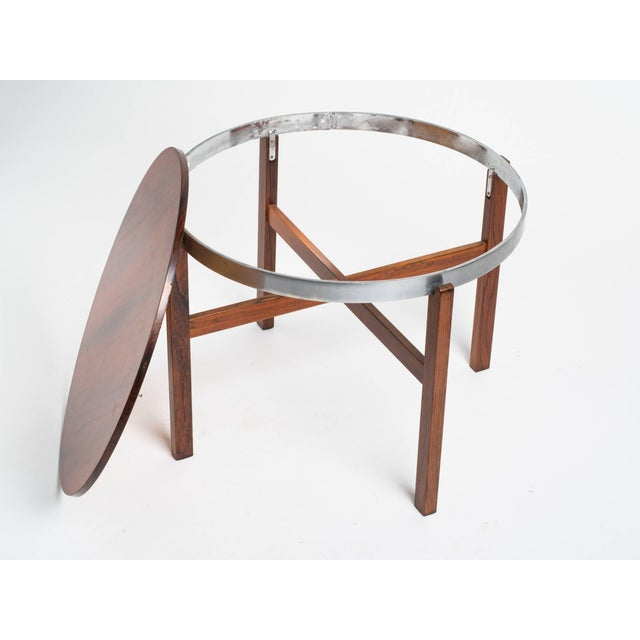 Rosewood side table stamped Norway. This item includes restricted materials and can not be sold outside of the contiguous...