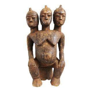 Carved Triplet Lobi Statue For Sale