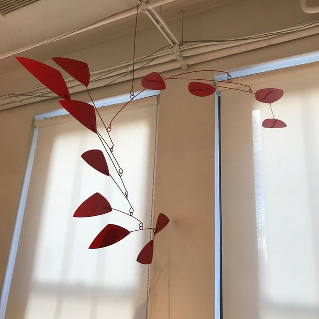 Abstract suspended sculpture of cut and painted steel, perfectly balanced, 2018. Hunter (born 1963) studied advertising...