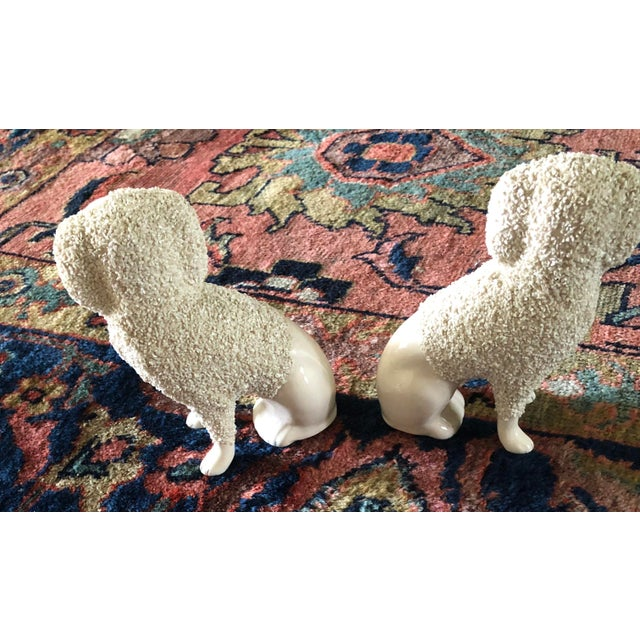 This pair of antique Staffordshire curly poodle mantel dogs are in good condition with separate legs. They are stamped PV,...