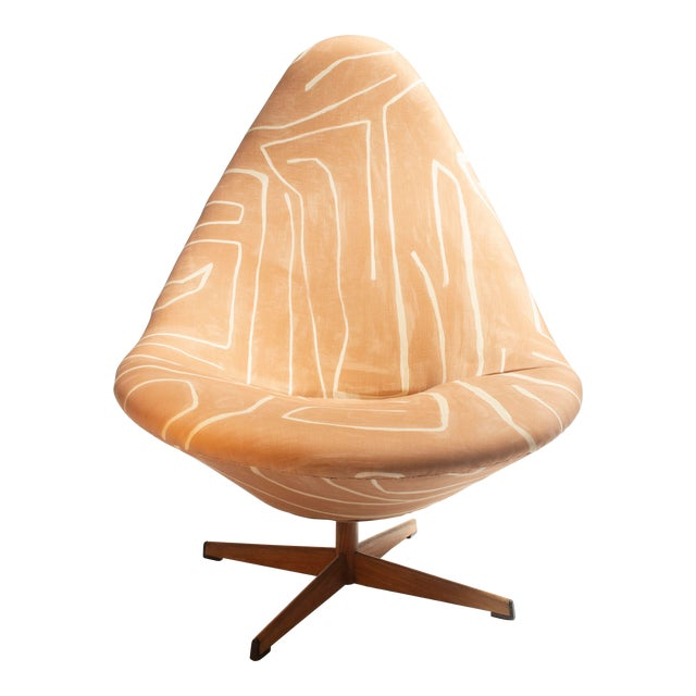 Generously sized swivel chairs upholstered in peachy terracotta Groundworks print with faux bois swivel base. Dramatic...